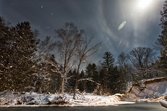 A Bend in the Pine (MightyBoyBrian) Tags: longexposure trees winter moon clouds bright michigan wideangle multipleexposure stacked startrails moonring hoxeyville pineriver 1635mmf28 ringaroundthemoon canon5dmark3tripod