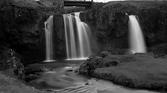 in the folds of Kirkjufellsfoss waterfall aka spot the shooter (lunaryuna) Tags: iceland westiceland snaefellsnespeninsula grundarfjordur kirkjufellsfoss waterfall le longexposure makingoff oru bridge spring season seasonalchange beauty evening lunaryuna blackwhite bw monochrome