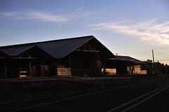 Closed Dairy Farm (Melissa_JMH) Tags: dairy milk building farm wood street road sky cloud clouds sun setting sunset hay nikon nikond700 d700 oregon silverton cow abandoned closed sale dairycow powerline tinroof photography fx