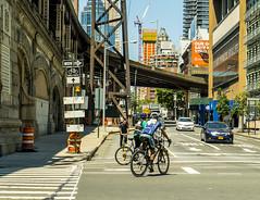 "Manhattan Candid Street Scene (nrhodesphotos(the_eye_of_the_moment)) Tags: dsc01759165""theeyeofthemoment21gmailcom"" ""wwwflickrcomphotostheeyeofthemoment"" candid people 1stavenue 60thstreet edwardkochqueensborobridge overpass structure bridge metal steel rooseveltislandtramstructure signs arrows bikers transportation riders bicycles crosswalk manhattan nyc pylons crane skyline skyscrapers buildings architecture billboards autos cars reflections shadows outdoor windows glass ramp road bike vehicle sidewalk perspective trucks"