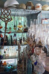 Carpet Beaters (AntyDiluvian) Tags: boston massachusetts northshore essex capeann antiques antiqueshop howardsflyingdragonantiques vintage carpetbeater rugbeater lamp oillamp