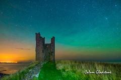 Lilburn Glow (Calum Gladstone) Tags: dunstanburgh castle lilburn tower nightscape air glow green stars samyang canon6d