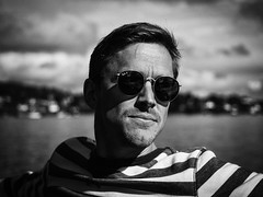 Portrait (eriknst) Tags: portrait bw olympus zuiko norway boat fjord man