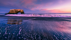 The Ebb And Flow (Ping...) Tags: naturalbridge pacificcoastline coastline sea dramatic surging ocean sky pink clouds wave ebb retreat blue beach california usa rock