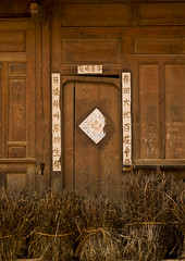 Old Door, Shaxi Old Town, Yunnan Province, China (Eric Lafforgue) Tags: china old color colour vertical architecture outdoors photography asia day village outdoor nobody nopeople ornate yunnan oldtown buildingfront bai traditionalculture shaxi eastasia chineseculture traveldestinations chineselanguage buildingexterior colorpicture chinesescript yunnanprovince colourimage residentialstructure traditionallychinese a0007540