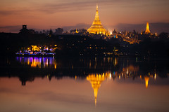 Shwedagon Pagoda : Kandawgyi Lake (rovinglight) Tags: sunset lake reflection religious gold golden pagoda twilight shwedagon royal icon paya attraction rangoon kandawgyi myanmarburma yangonregion