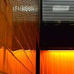 Orange wedge (TheManWhoPlantedTrees) Tags: music orange black glass warm curtain flame tiles 100views chemicalbrothers bsquare energetic quadratum myphotost tmwpt