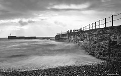 Sea wall (Steve Denny) Tags: sea storm clouds seaside waves stones sony pebbles hastings eastsussex englishchannel stormclouds manfrotto timedexposure a300 ndfilters