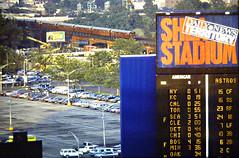 "Scoreboard with ""redbirds"" (en tee gee) Tags: newyorkcity red newyork train subway baseball stadium parking elevated irt"