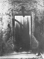 Of the Ruin (mynamesdonny) Tags: door light blackandwhite galveston abandoned monochrome mono texas decay ruin olympus urbex epl1 stewartsmansion