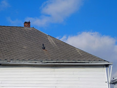 Blue Sky - Asbestos Roof (Asbestorama) Tags: blue roof chimney sky cloud house bird home weather vent shingles inspection shingle erosion gutter siding residence residential survey acm downspout roofing erode asbestos chamfered