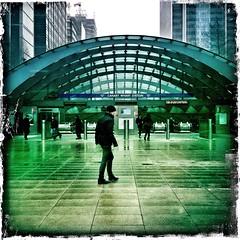 at the station (sheila mckinney) Tags: uk winter snow london station underground tube canarywharf drama2 johnslens january2013 hipstamatic kodotxgrizzledfilm iphone4s snapseed