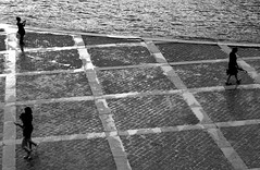 Everyone goes their own way, (isobrown) Tags: black noir blackandwhite triangle people paris seine sillouettes smartphone lines pavement water outdoor geometric geometrique angles minimalisme