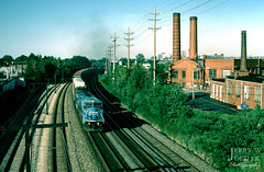 Leaving the home of Rock 'n Roll (jwjordak) Tags: freightcar c408w autorack cr 6197 brick trainml433 pole wires smokestack unittrain catenary train lakewood ohio unitedstates us