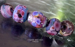 Rounds and Rock Mauve (Laura Blanck Openstudio) Tags: openstudio openstudiobeads glass handmade lampwork beads bead set jewerly murano big fine arts artist artisan show festival wearable pebbles stones rocks nuggets faceted transparent whimsical funky odd colorful multicolor organic earthy abstract asymmetric frit speckles made usa published winner category south miami translucent opaque matte glow rare etched frosted mauve lavender lilac rose purple violet gray enamel enameled yellow ocher pink fuchsia ruby encased metallic iridescent copper green pearled rounds rock