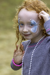 A shy wave. (crabsandbeer (Kevin Moore)) Tags: baltimore children horserace kids legacychase maryland people september girl cute face faceprint wave child childhood redhead smile youth blueeyes