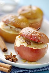 Baked Apples with Marzipan Filling (Thorsten (TK)) Tags: blue autumn winter red food germany dessert baking sweet bokeh cinnamon traditional seasonal raisins depthoffield german almonds apples marzipan easy tradition baked foodphotography almondpaste staranise powdersugar bakedapples bratapfel marchpane boskop slicedalmonds thprstenkraska