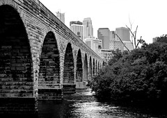 Stone Arch Bridge (Liz Nemmers) Tags: bridge trees summer blackandwhite bw water minnesota skyline buildings photography nikon cities minneapolis landmark mississippiriver twincities hdr 2012 stonearchbridge minneapolisminnesota photomatix minneapolisskyline nikond3100