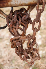 Rusty Chains (Jim Frazier) Tags: old winter usa snow cold detail cars texture metal closeup boat chains illinois highway rust mess iron december cloudy lock steel rusty overcast security heavymetal cadillac il vehicles study messy lincoln secure trailer links locked classiccars automobiles nexus 2012 chained tangled rochelle connections unorganized lincolnhighway ogle oglecounty torcwori lddecember jimfraziercom ld2012 wmembed 20121228rochelletripjimfraziercom jimfraziercom 20121228rochelletrip