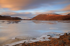 Icy Loch Droma. (Gordie Broon.) Tags: winter mountains ice nature clouds reflections landscape geotagged photography scotland scenery alba scenic escocia hills explore schottland ullapool westerross ecosse scottishhighlands anteallach beinn lochdroma aultguish meallbreac canoneos7d gordiebroon icyloch enaiglair braemorejunction mealldoirefaid