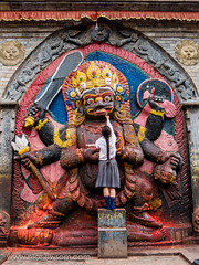 Kala Bhairava (nilanewsom) Tags: old travel school nepal sculpture black tourism worshipping lamp girl statue rock stone dark asian temple carved ancient worship asia god action kali painted indian religion lifestyle icon carving offer butter angry figure offering kathmandu shiva schoolgirl hindu hinduism durbar kala deity newsom sculpted naga nila guee mudra sculptured ghee fearesome bhairon bhairava kalabhairava bhairo nilanewsomcom nilanewsom bhairadya