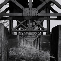 under the tracks (emergrn) Tags: bw square 50mm under traintracks railway repetition underneath canonef50mmf18ii 7daysofshooting blackandwhitewednesday week27repetition