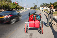 Leaving Salalah (www.AlastairHumphreys.com) Tags: car cart salalah busyroad