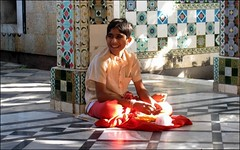 In the Sunbeam (Vincentdevincennes) Tags: portrait people orange india colors temple colorful faith belief streetlife hinduism gujarat jamnagar