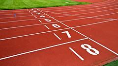 Numbers of starting line track (Santeri Viinamaki) Tags: numbersofstartinglinetrack trackandfield athleticsfield athletic startingline startline runningtrack athleticstrack number numbers 18 red yleisurheilu