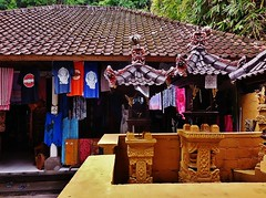 shrines at the shops (SM Tham) Tags: asia indonesia bali island candidasa town shrines enclosure walls plinths shops clothes roofs rooftiles outdoors