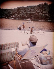 Lomochrome Turquoise in the Poconos (DannyOKC) Tags: beach sun hat lomochrome homeprocess c41 fauxinfrared fakeinfrared faux fake ir lake vignette 120 mediumformat plasticfantastic plasticlens toycamera turquoise digitalcantdothis