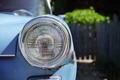 The old blue Benz, revisited (again) (Eric Flexyourhead) Tags: edison skagitcounty washington usa car german mercedesbenz 200d mercedesbenz200d w110 fintail heckflosse blue faded old weathered worn patina detail fragment headlight headlamp shallowdepthoffield bokeh sonyalphaa7 zeisssonnartfe55mmf18za zeiss 55mmf18