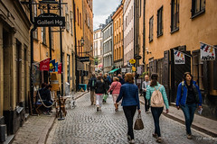 2016 - Baltic Cruise - Stockholm - Osterlangg Street (Ted's photos - For Me & You) Tags: 2016 cropped stockholm sweden tedmcgrath tedsphotos vignetting gamlastan gamlastanstockholm oldtownstockholm streetscene street people peopleandpaths cobblestones