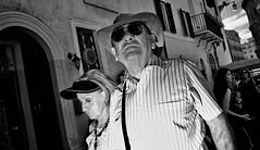 Tu sei un cazzo, I think he said I was a cat!!!!! (you must look it up if you don't speak Italian) (Baz 120) Tags: candid candidstreet candidportrait city candidface candidphotography contrast streetfaces street streetphoto streetcandid streetphotography streetphotograph streetportrait rome roma romepeople romecandid romestreets monochrome monotone mono blackandwhite bw urban noiretblanc voigtlandercolorskopar21mmf40 life leicam8 leica primelens portrait people unposed italy italia grittystreetphotography faces flash flashstreetphotography decisivemoment strangers