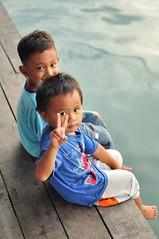 Kids Hanging Around (photo-razzo) Tags: light boy portrait people face 35mm asian k