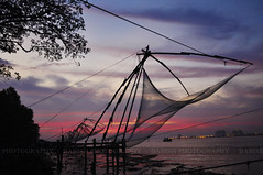 Fort Kochi - A December Evening... (Babish VB) Tags: sunset kerala cochin kochi fortkochi fortcochin chinesefishingnet keralatourism heartawards platinumheartaward yahoo:yourpictures=sunset yahoo:yourpictures=kerala yahoo:yourpictures=kochi yahoo:yourpictures=cochin yahoo:yourpictures=fortkochi yahoo:yourpictures=fortcochin
