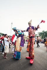 The Clowns with Flags (syukaery) Tags: street carnival indonesia nikon flags jakarta 20mm clowns monas nationalmonument d700