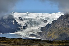 (ThePieCo) Tags: road travel mountain mountains cold green ice nature water grass landscape island fire iceland nikon europe crossing pavement farm peak glacier trail valley geyser skaftafell d90