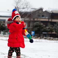 Happy New Year~ (Eason Q) Tags: china portrait people playing weather childhood smiling horizontal standing outdoors photography holding child shanghai joy happiness innocence snowball blizzard enjoyment oneperson happynewyear 34years colorimage waistup 2013 childrenonly onegirlonly warmclothing coldtemperature chineseethnicity gettychina13q1