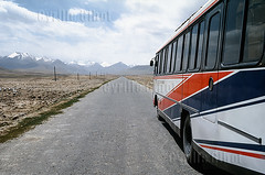 Bus on the Chinese section of the Karakoram Highway, which connects China and Pakistan across the Karakoram mountain range, Xinjiang Province, China (Cyrille Gibot) Tags: china road travel mountain bus tourism horizontal outdoors desert plateau altitude horizon transport nobody nopeople ridge xinjiang silkroad karakoram range province highup karakoramhighway