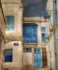 Rue Ben Mahmoud (Cat Girl 007) Tags: door old city windows sky urban house color home stone by facade outdoors photography ancient colorful apartments cityscape rustic lifestyle structure historic neighborhood textures flats sidewalk exotic photograph arab worn shutters housing medina charming shelter tenement nationalgeographic dwelling gaff explored skeletalmess phototakenon121212 hafsidstyle