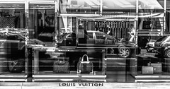 Louis Vuitton reflections (graatsie) Tags: windows refletions louisvuitton pchooftstraat tassen shoppingwindows amsterdam holland zw fujixt1 fujinonxf35mmf2rwr
