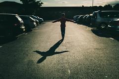 The kid and the shadow (Braiu) Tags: leo candid candidportrait carpark city cross light shadows street streetphotography sunset urban walking