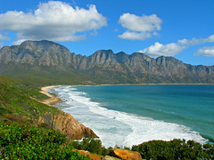 Along the Coast (Sandra Leidholdt) Tags: coast beach bay coastline southafrica southafrican africa african za sandraleidholdt bettysbay surf ocean sea seacoast atlanticocean westerncape shore mountainrange shoreline mountains bloukrans seaside mountain bluff landscape water serene waterfront ridge cliff hill kogelbay