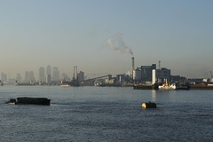 Smoke from Tate and Lyle (will668) Tags: uk greatbritain chimney england london tower water ferry thames buildings river boats boat industrial factory unitedkingdom crane smoke tide towers cranes bouy riverthames thamesbarrier woolwichferry woolwicharsenal tateandlyle