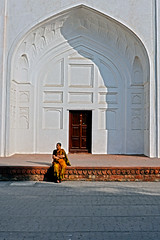 The last of the afternoon sun; Naubat Khana, Red Fort, Delhi (MJ Reilly) Tags: door autumn sunset shadow woman sun india color colour monument nikon waiting alone arch delhi rest colourful sat sunbathe redfort shahjahan olddelhi mughal lalqila d90 lalqilah