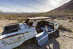 Rhyolite Nevada Ghost Town (Richard Ellis Photography) Tags: travel usa southwest building abandoned tourism car horizontal trash rural america outdoors us day unitedstates desert nevada debris rustic bluesky nobody nopeople landmark tourist structure nv rusted rubbish ghosttown remote rusting rhyolite wildwest arid attraction miningcamp nyecounty bullfroghills
