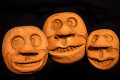 Peering over the fiscal cliff. (Daniel Light) Tags: faces fear nuts clay heads surprise trio christmasgifts wideeyes wwwkentuckyartsorg artistbobbrigl