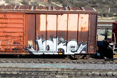 JOKE (QsySue) Tags: railroad digital train lumix graffiti tag traintracks panasonic traincar pointandshoot digitalcamera railroadtracks railroadcar inlandempire sanbernardinocounty digitalpointandshoot panasoniclumixdmczs8