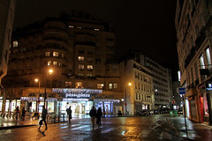 Rue de Passy - Paris (France) (Meteorry) Tags: people paris france building car night facade reflections mall shopping lights evening europe lumire january gap zebra crosswalk soir nuit humid lampposts passy humide meteorry 2013 ruedepassy passyplaza